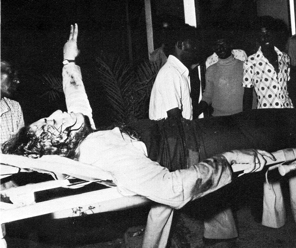 Souhaila Andrawes gives the victory sign as she is taken awayon a stretcher: the three other members of her commando had been killed